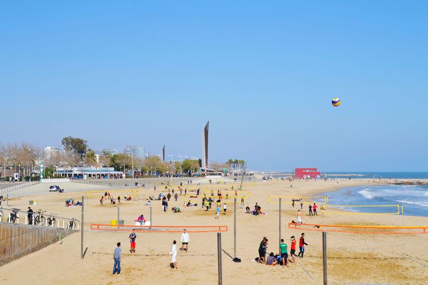 Beach Large Group Of People Outdoors Sand Vacations Day Sky People Water Sea Barceloneta Sport Balls Ball Volleyball Volley Ball In The Air