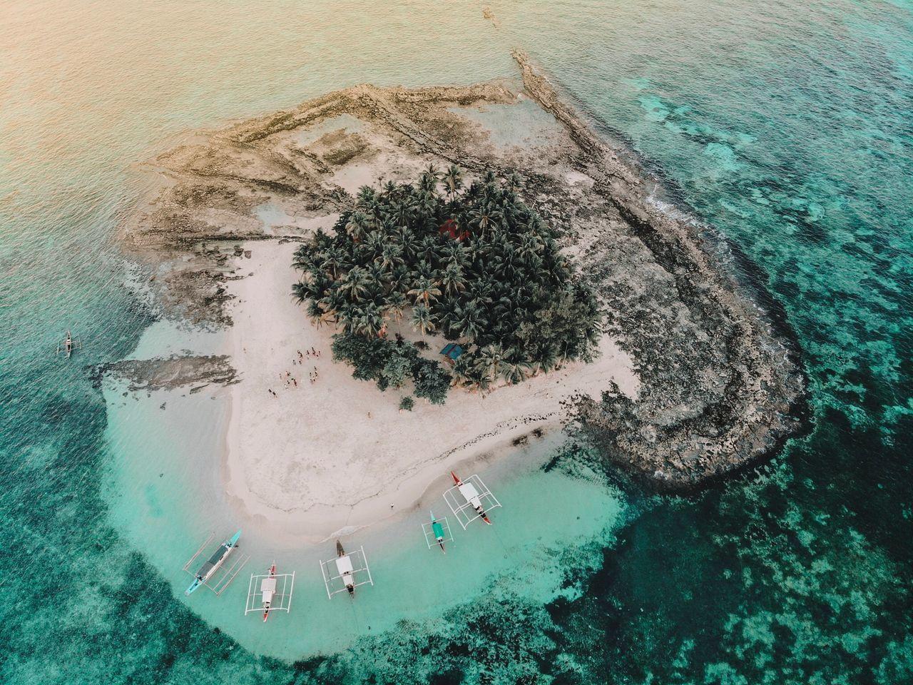 HIGH ANGLE VIEW OF BEACH UMBRELLAS
