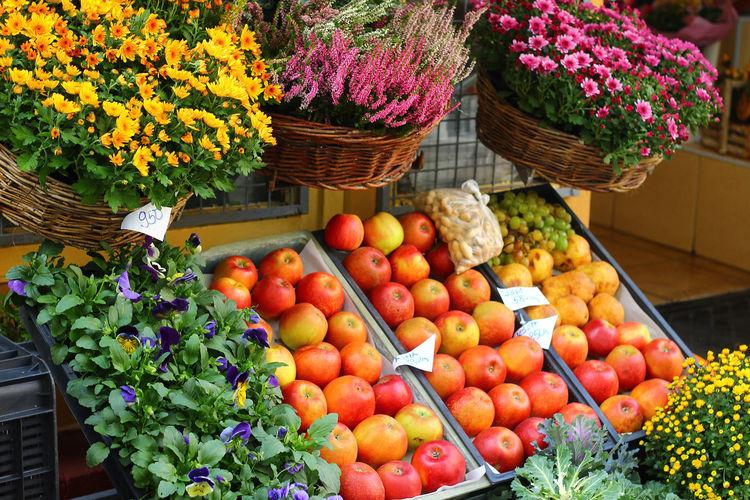 Various fruits in basket at market stall