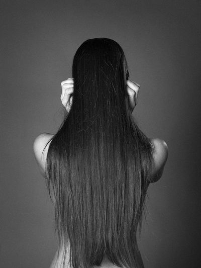Rear View Of Woman With Long Straight Hair