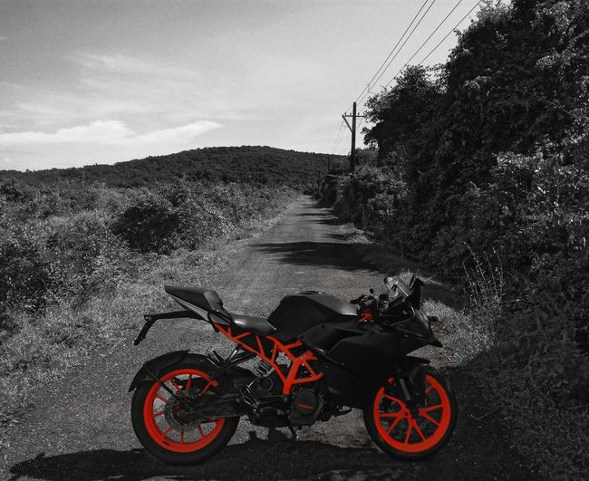Monochrome monochrome photography Blackphotography Blackandwhite Black & White Black And White Colors Absence Ktm Rc200 Transportation Motorcycle Mode Of Transport Red Road Cloud - Sky Day