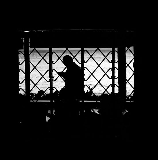 Silhouette Window Indoors  Architecture Day No People Traveling Instamood Helloworld Iponeonly EyeEmBestPics EyeEm Best Shots EyeEm Art Is Everywhere Bnw Pattern Travel Photography Travelphotography Communication Smartphonephotography Smart Simplicity Exploring New Ground Exploring Man On Phone Turistando Place Of Heart Black And White Friday Love Yourself This Is Aging