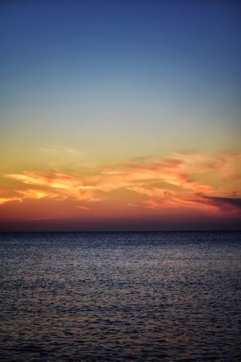 Tranquil Scene Sunset Sea Scenics Tranquility Beauty In Nature Water Horizon Over Water Nature Sky Idyllic Cloud - Sky Rippled No People Outdoors Beach Silhouette Travel Destinations Day