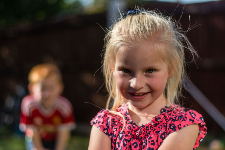 Close-up portrait of girl smiling outdoors