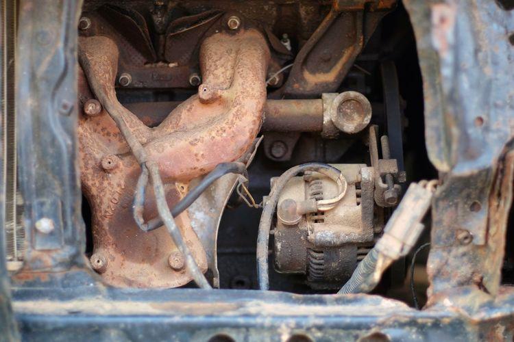 Close-up of rusty machine part of train