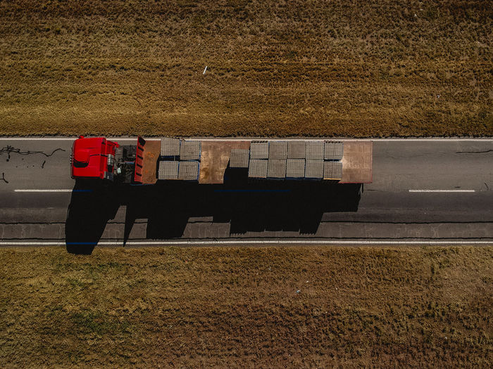 High angle view of construction materials on truck at field during sunny day