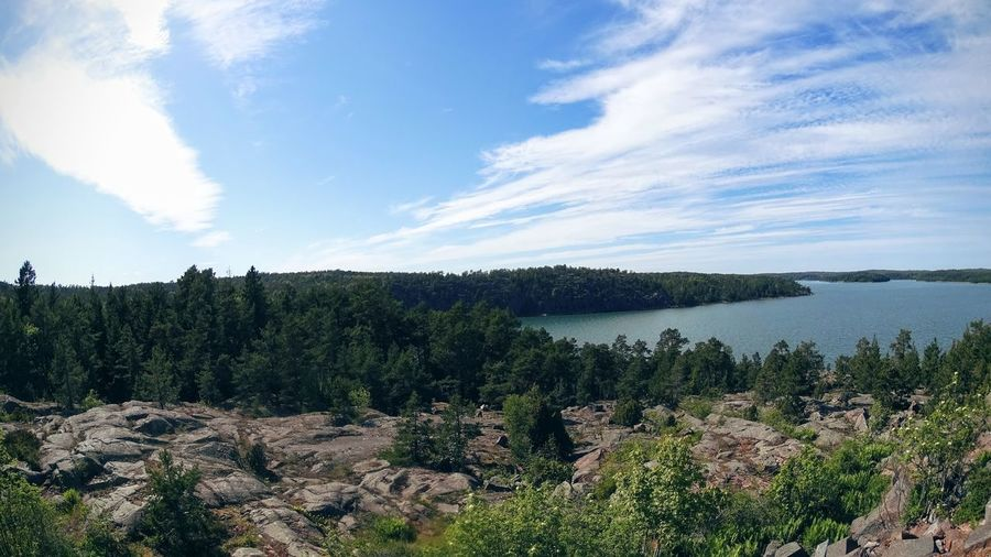 from the top of the hill, the calm sea around Aland Aland Islands Beauty In Nature Countryside Exploring Fotostrasse Geology Lake Landscape Lush Foliage Nature No People Non-urban Scene Outdoors Physical Geography River Scenics Tranquil Scene Tranquility Tree Trip Visit Ala Voyage Water