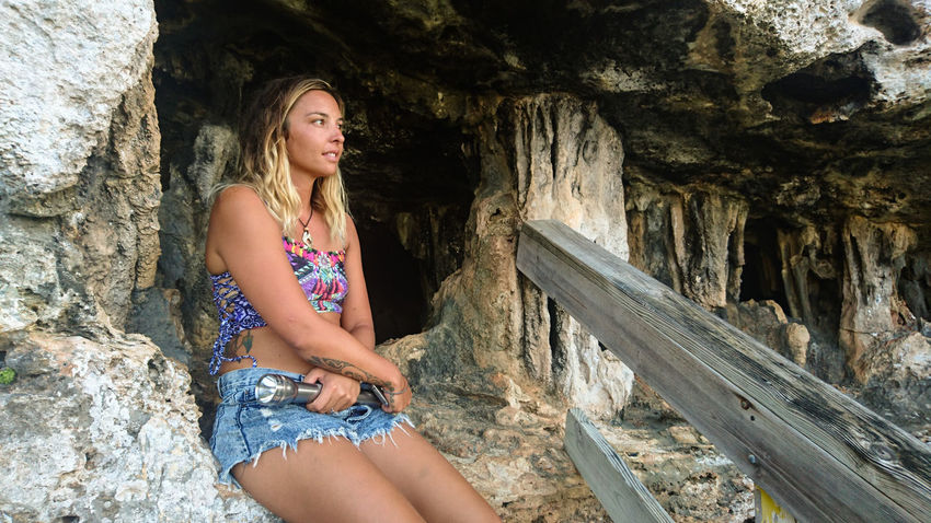 Young Adult Person Cave Long Hair Casual Clothing Contemplation Day Rock Formation Outdoors Rock Vacation Caribbean Nature Scenics Beauty In Nature Outlook Cayman Caymanbrac Cayman Islands Relaxation