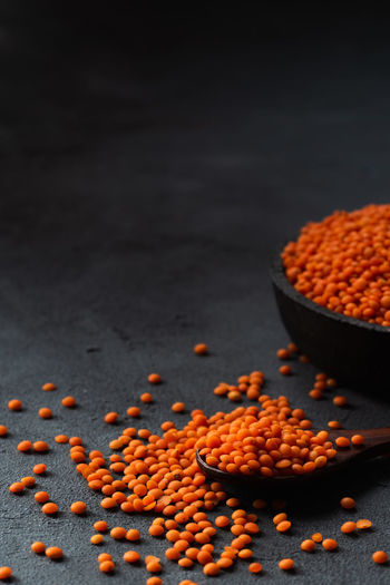 red lentils with negative space on a dark background   daylight foodphotography Food Food And Drink Freshness Still Life Indoors  Close-up No People Healthy Eating Raw Food Selective Focus Lentil Large Group Of Objects Red Vegetarian Food Focus On Foreground Vegan Food Photography Foodphotography Daylight Photography Moody Dark Mood Dark Background negative space Nikonphotography Red Lentils
