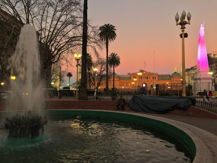 Obelisk Plaza De Mayo Mayo Square Casa Rosada Fountain Homeless People Water Mayo Square Illuminated Architecture Built Structure Night Building Exterior Street Light Motion Outdoors Long Exposure City Tree Real People Sky Nature