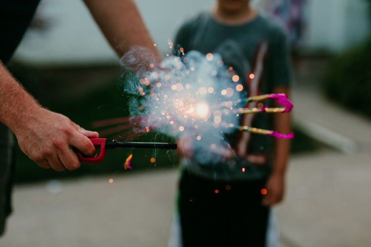Close-up of hand holding sparkler