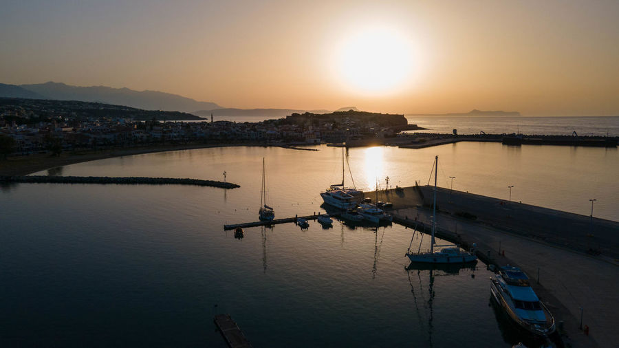 View of harbor at sunset