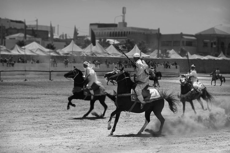 People Riding Horse During Race