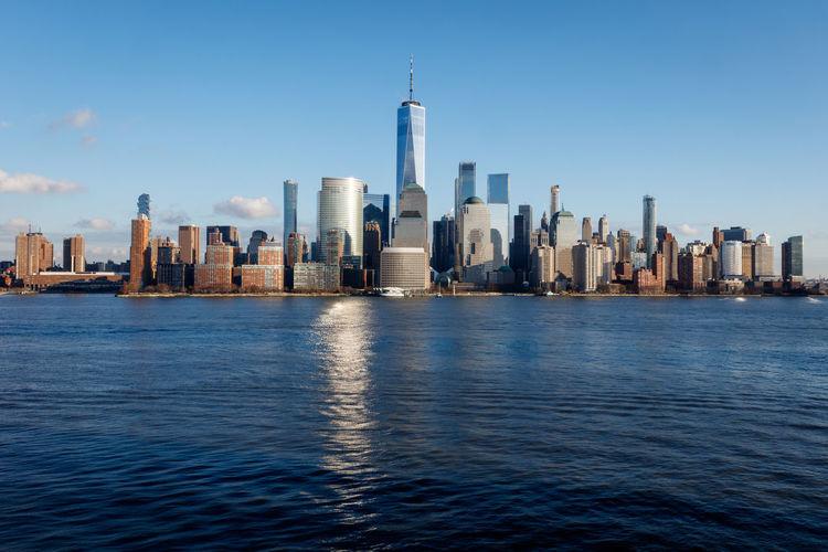 New york city manhattan skyline daytime with one world trade center tower across hudson river