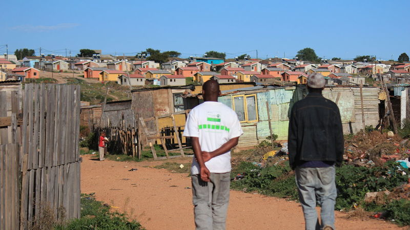 Stroll through the townships Building Exterior Casual Clothing Clear Sky Colourful Houses Colourful Houses Day House Lifestyles Men Outdoors Poverty Residential Building Residential Structure Standing Struggle For Life Sunlight Township Life Townships Walking Walking Together