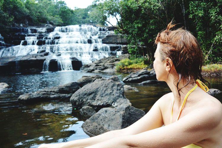 Woman looking at waterfall