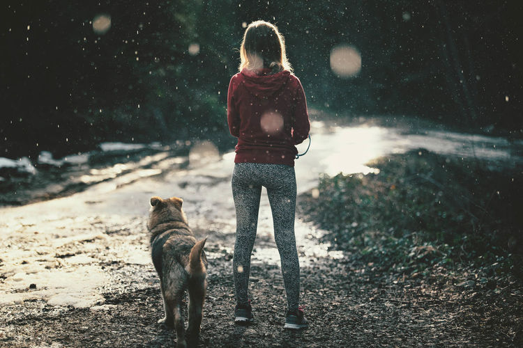Animal Day Dog Domestic Animals Film Forest Friends Friendship Full Length Girl Green Green Color Loyalty Mammal One Animal One Person Outdoors Outside Pets Rain Raindrops Rainy Days Spring Togetherness Women