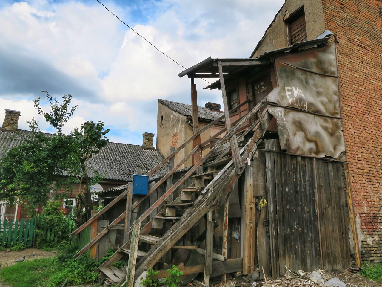 built structure, building exterior, architecture, house, cloud - sky, sky, damaged, outdoors, abandoned, day, no people, bad condition, tree