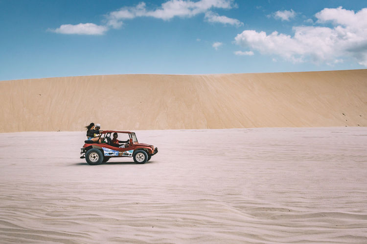 On our way through the desert! Bright Buggy Car Cloud - Sky Day Desert Girl Good Times Happy Landscape Mode Of Transport Nature Outdoors People Sand Sand Dune Sandy Sky Sky And Clouds Transportation Travel Travel Destinations Travel Photography Traveling Young Women The Street Photographer - 2017 EyeEm Awards The Great Outdoors - 2017 EyeEm Awards The Photojournalist - 2017 EyeEm Awards EyeEmNewHere Let's Go. Together. Sommergefühle EyeEm Selects Sommergefühle Lost In The Landscape Connected By Travel An Eye For Travel Focus On The Story This Is Latin America The Traveler - 2018 EyeEm Awards The Great Outdoors - 2018 EyeEm Awards Summer Sports A New Beginning A New Perspective On Life