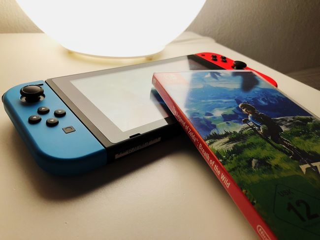 Touch Screen Human Body Part Gaming Time IPhoneography Wireless Technology Technology High Angle View IPhone Game Nintendo Switch Nintendofan Photography Breathofthewild Nintendolife Gaming Beautiful Gaminglife Gamer Instagramer Nintendo Zelda Device Screen Light And Shadow Modern Close-up