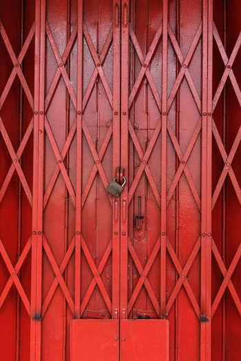Closed red metallic gate