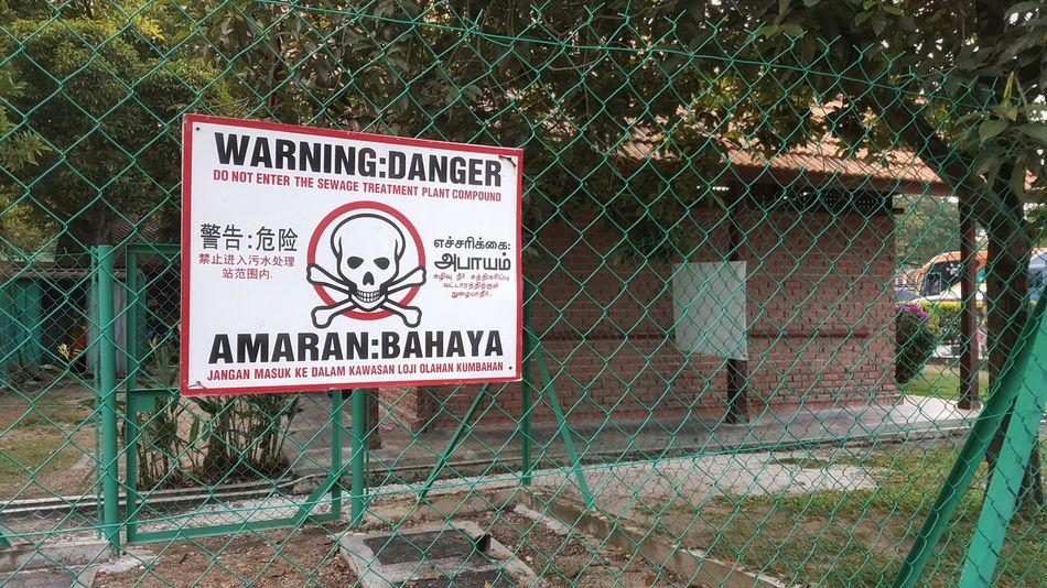 Danger sign Jolly Roger Text Information Sign Green Color Symbol No People Outdoors Day