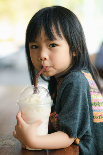 Casual Clothing Child Childhood Cute Drink Drinking Drinking Straw Females Focus On Foreground Food And Drink Front View Glass Holding Innocence Lifestyles One Person Portrait Real People Refreshment Straw