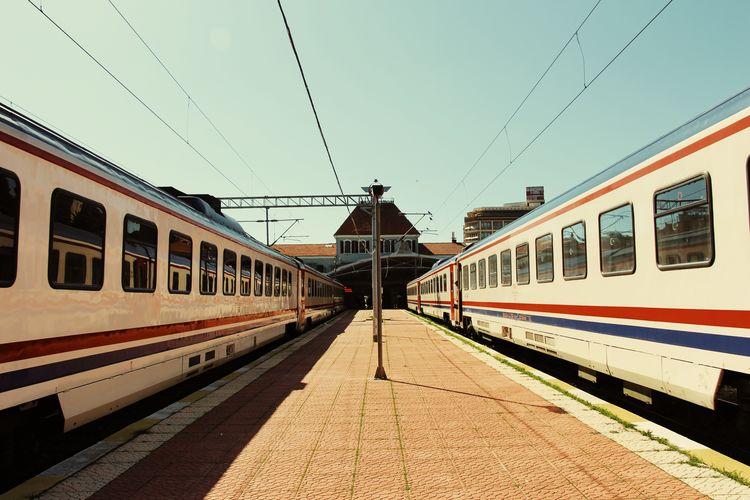 Train on railroad station platform against clear sky
