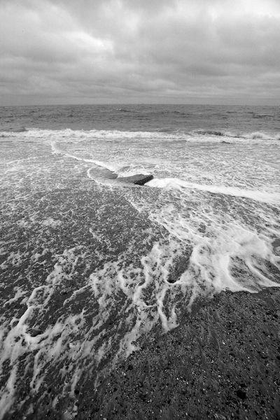 Surf Swirling Around The Stone Rock Surf Blackandwhite Block Cloud - Sky Motion Nature Sea Sky Stone Water Wave