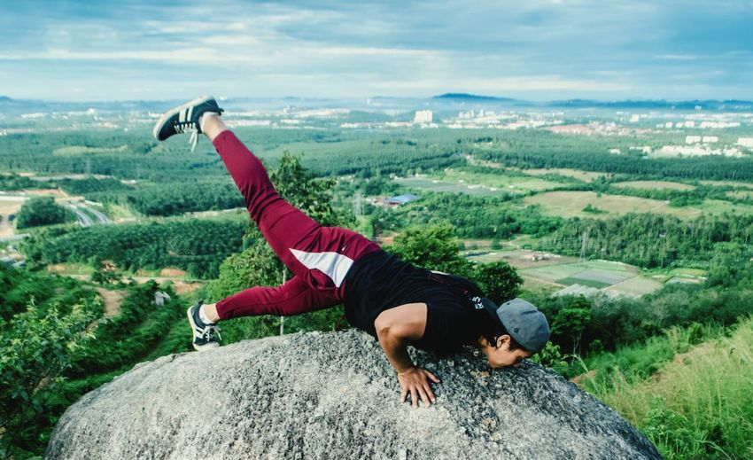 Man exercising on cliff