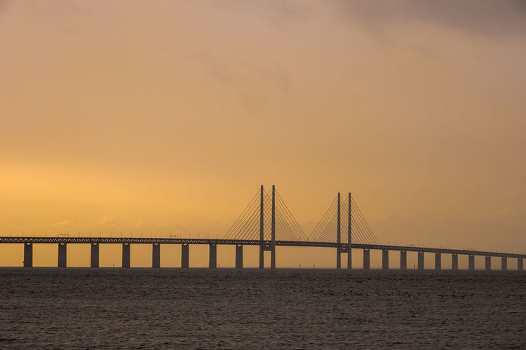 Bridge Bridge - Man Made Structure Built Structure Connection Engineering Long Outdoors Sunset Suspension Bridge Water Waterfront öresund Landscapes With WhiteWall