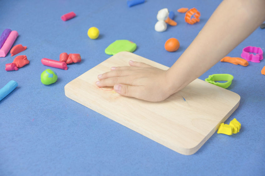 My son plays the clay Molding Clay Ball Child Childhood Children Only Close-up Day Human Body Part Human Hand Indoors  Leisure Activity Multi Colored One Person People Playing Pool Ball Pool Table Table
