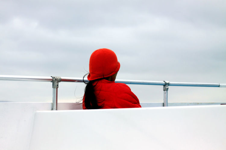 Rear view of woman on boat deck