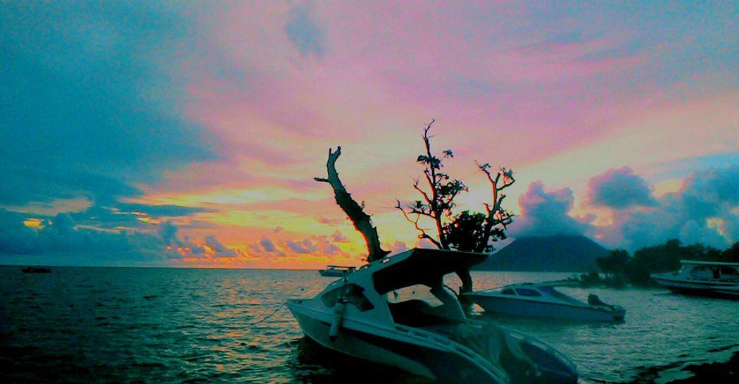 Bunaken Island SeaShip Sea And Sky Sunset Bunaken Island Manadotua Sulawesiutara Indonesia_photography Indonesian Street (Mobile) Photographie Outdoors No People Beauty In Nature Beach Nautical Vessel Nature Horizon Over Water Day
