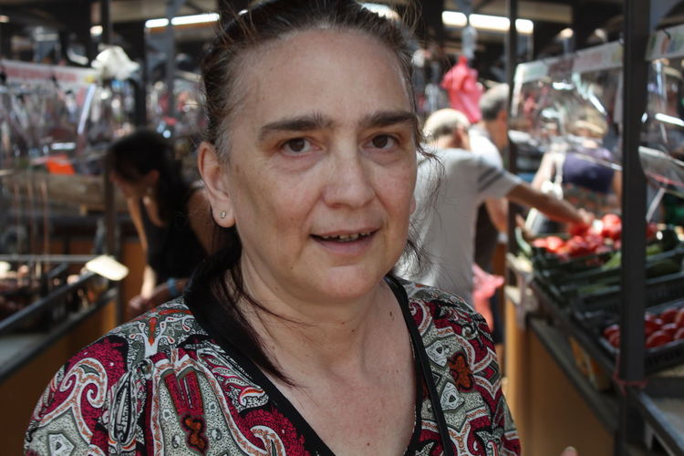 Portrait of smiling mature woman in market