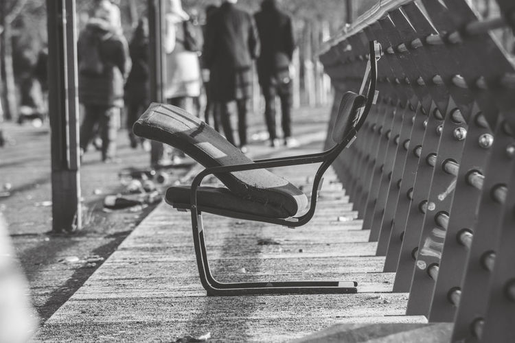 Metal Day In A Row Focus On Foreground Incidental People Park Empty Selective Focus Park - Man Made Space Seat Outdoors Nature City Sunlight Group Of People Park Bench Lifestyles Bench Street Architecture Chair monochrome photography EyeEm Black&white!