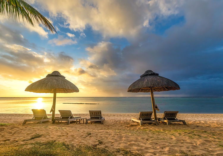 Beach Sunset Sun Holidays Travel Mauritius Sand White Great Views Water Beauty In Nature Tranquility Chair Lounge Chair Outdoors No People Cloud - Sky
