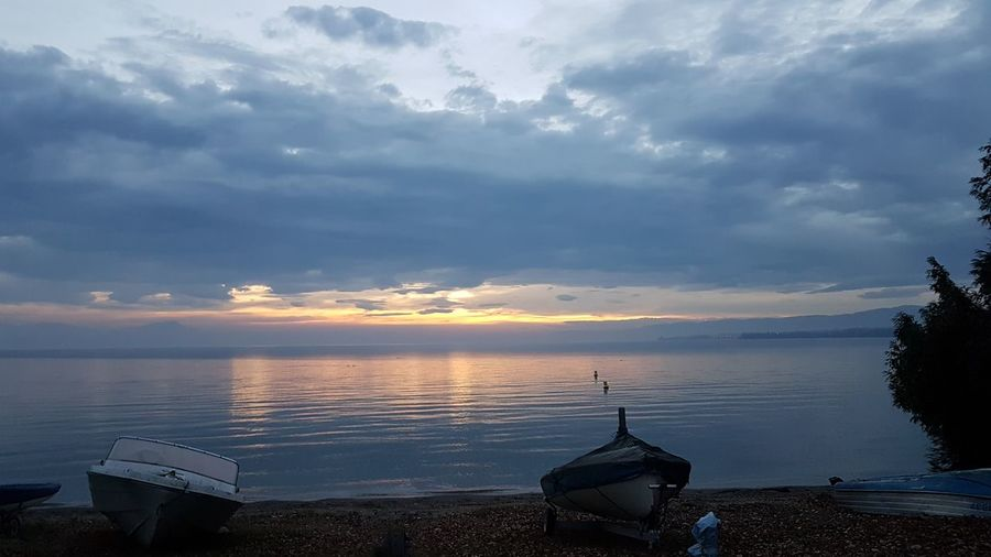 Nautical Vessel Water Tranquility Sunset Reflection Landscape No People Beach Nature Sky