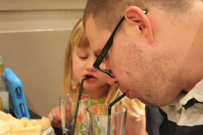 Just juice! Father And Daughter EyeEm Selects Real People Indoors  Food And Drink Home Interior Childhood Drinking Two People Headshot Eyeglasses  Lifestyles Drink Drinking Glass Boys Close-up Freshness Food Day People