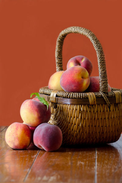 wicker basket of fresh peaches Agriculture Fall Colors Freshness Nature USA Basket Close-up Container Food Food And Drink Freshness Fruit Healthy Eating Indoors  Juicy Fruit Michigan Peaches Orange Color Organic Peanuts Peach Still Life Table Wellbeing Wicker Wood - Material Yellow