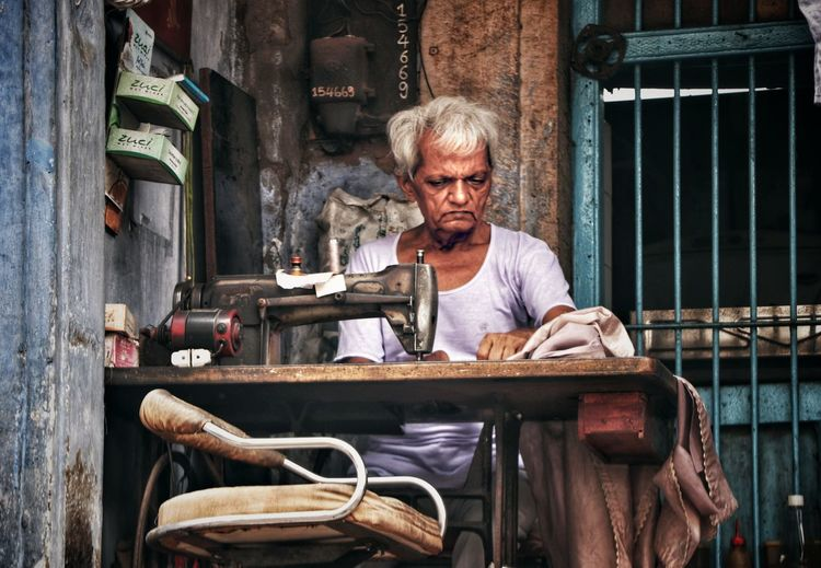 THE PICTURE ARE THERE, YOU JUST TAKE THEM Canonphotography Canon77d Googlesnapseed Mahens10j Streetphotography Potrait_photography Street Market Mahen10j Streetphoto Oldman Oldmanportrait Street Life Street Portrait Portrait Gray Hair Men Sitting Looking At Camera Senior Adult Senior Men Front View