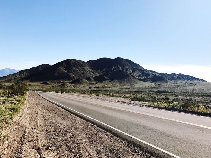 Mountain Road Copy Space Scenics Clear Sky Non-urban Scene Nature Landscape The Way Forward Tranquility Remote Outdoors Beauty In Nature Tranquil Scene Physical Geography Winding Road Geology Transportation Day No People Desert Roadtrip Highway