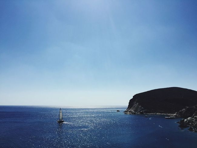 Deep blue sea in Folegandros island Folegandros Island Life Island Cyclades Cyclades_islands Greece Summer Sea Blue Sea Rocky Beach Summer Views Summer Holidays Vacations Little Boat Boat View From Above Water Sports Sailing Ship Sailing
