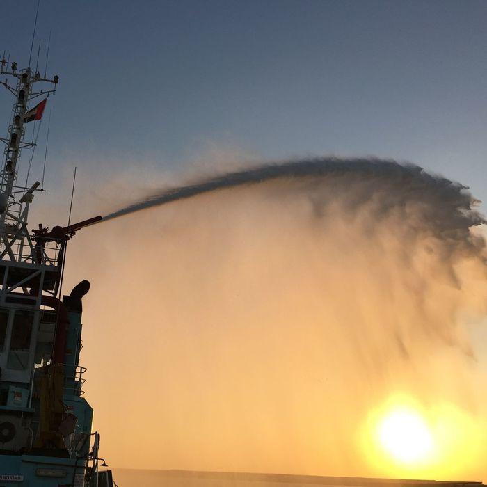 Uae,abudhabi company Ship testing its FireFighting . Good job captain but can't put off the Sun !!