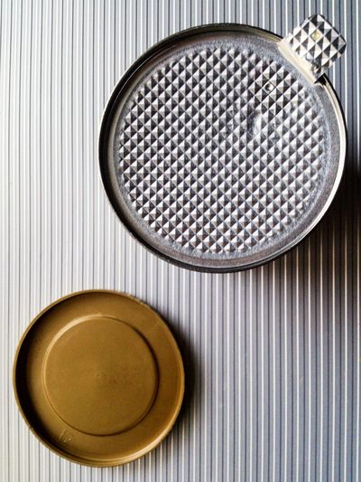 Directly above shot of lid and coffee tin on table