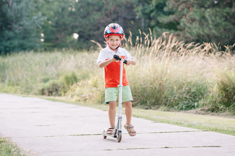 Portrait of a boy riding motorcycle