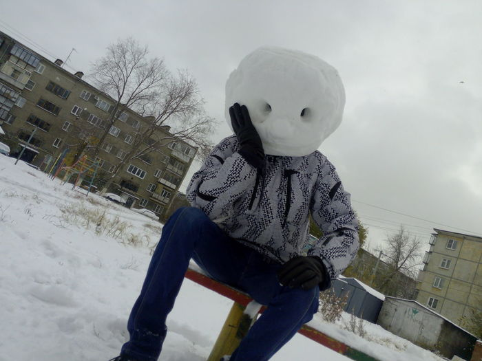 Architecture Building Exterior Built Structure Childhood Cold Temperature Day Nature One Person Outdoors Showhead Sitting Sky Snow Snow Helmet Warm Clothing Weather Winter