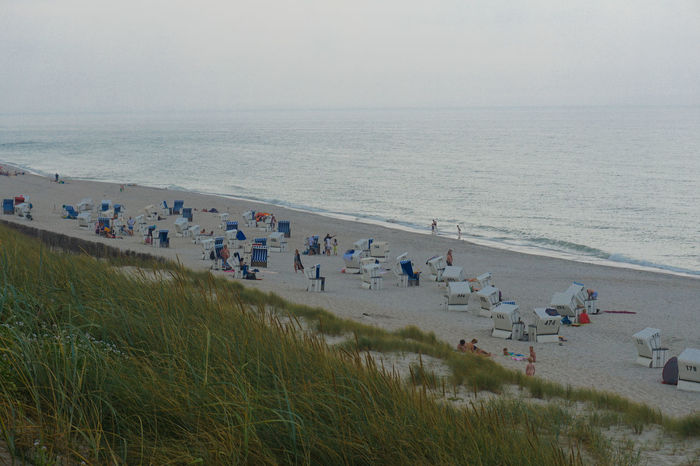 Beauty In Nature Day Enjoyment Grass Horizon Over Water Large Group Of People Leisure Activity Lifestyles Mixed Age Range Nature Northsea Outdoors Scenics Sea Shore Sky Sylt Sylt Strand Sylt, Germany Sylt_collection Tourist Tranquil Scene Tranquility Vacations Water