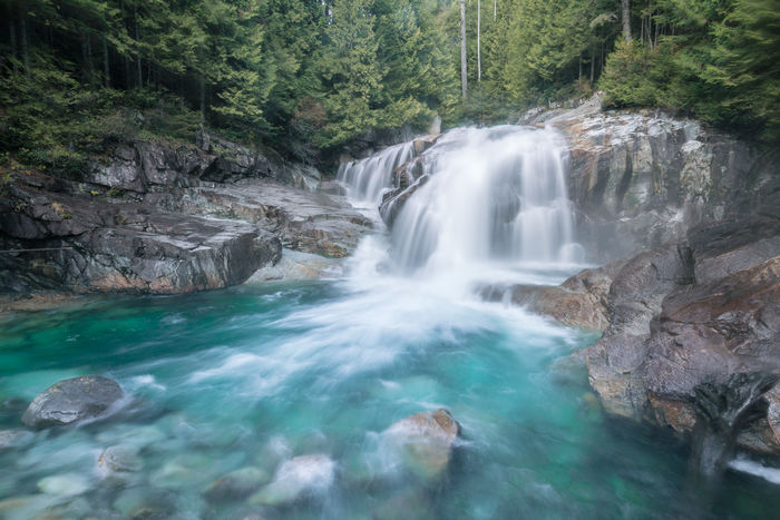 The Lower Falls along Gold Creek taken a few weeks ago in Golden Ears Provincial Park. I was shocked at how busy this place was until we asked some people who told us there was a Vancouver #socality instameet happening. We then watched in horror as someone lost control of a two week old drone in the updraft coming off the waterfall which hit an overhanging tree branch and promptly plunged into the falls never to be seen again. I headed out off track into the forest to find some peace from the crowds for a while then came back to take this shot under heavy spray from the waterfall just before dusk with the falls to ourselves. We then almost got trapped in the park as unbeknownst to us they lock the gates at 5:30pm sharp at this time of year. Luckily there was still a ranger there who let us though so I did not miss my flight! Golden Ears Provincial Park, British Columbia, Canada. Love Life, Love Photography British Columbia, Canada Forest Walk Gold Creek Golden Ears Provincial Park Rock Formation Beauty In Nature Blurred Motion Cascades Day Falls Forest Forest Photography Long Exposure Lower Falls Motion Nature No People Outdoors Rock - Object Scenics Tranquil Scene Tranquility Tree Water Waterfall