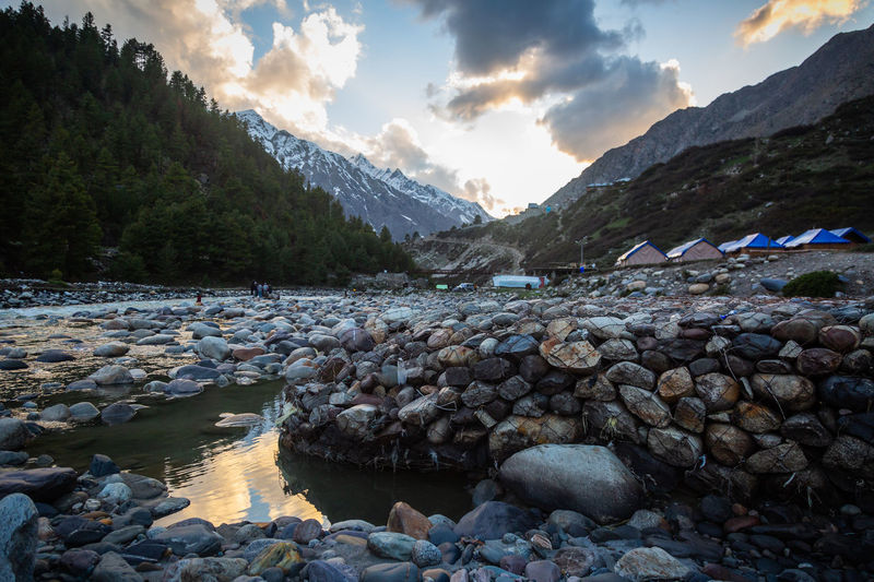Serene Water Sky Cloud - Sky Rock Scenics - Nature Mountain Beauty In Nature Solid Nature Rock - Object Tranquility Tranquil Scene Stone - Object Non-urban Scene No People Mountain Range Day Stone River Pebble Outdoors Flowing Water Flowing The Great Outdoors - 2019 EyeEm Awards Sunset
